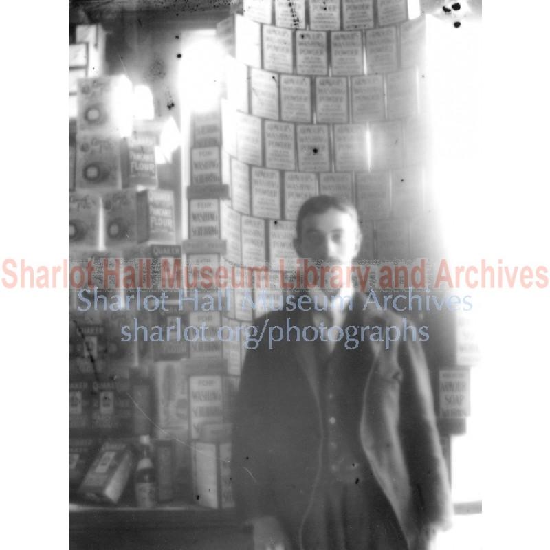 Unidentified man in unidentified general store warehouse