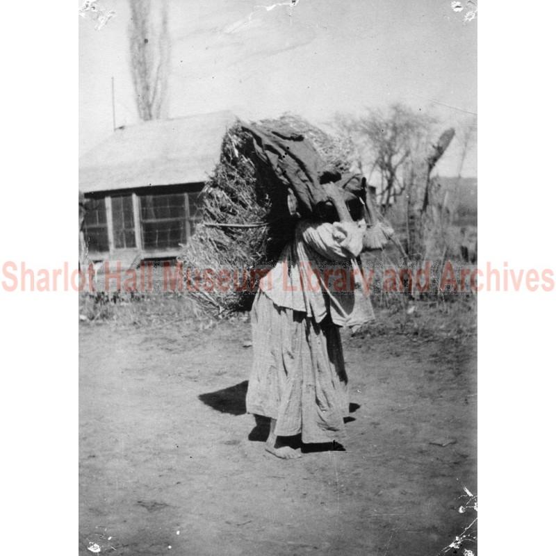 Apache Indian Woman Carrying a Bale of Hay, Gisela, Arizona