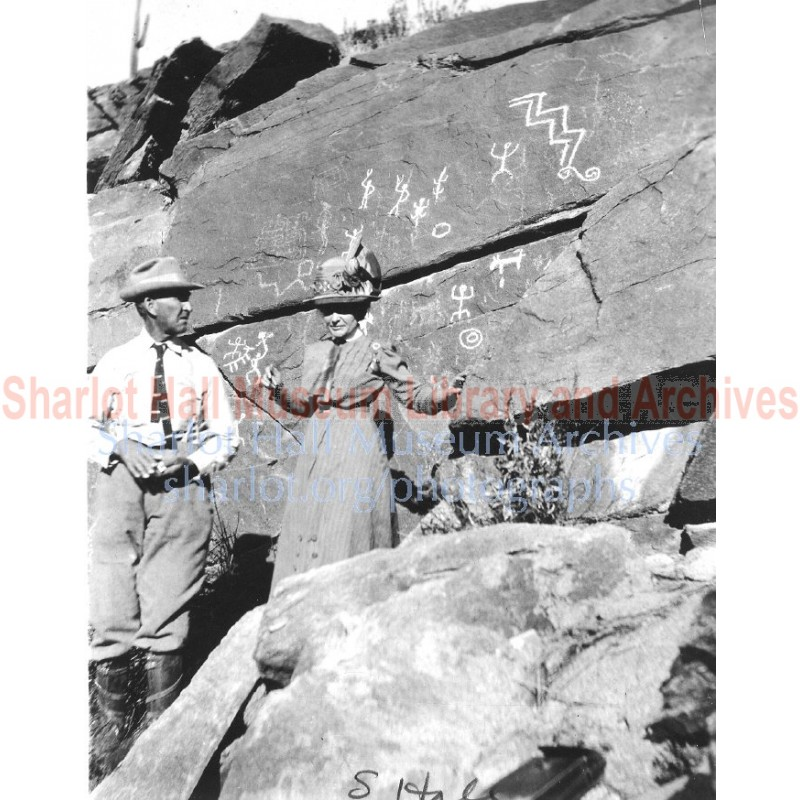 Sharlot Hall and man standing before Picture Rock