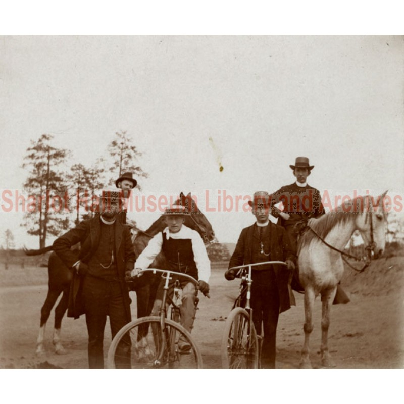 Two late 19th century bikes and a group of clergymen