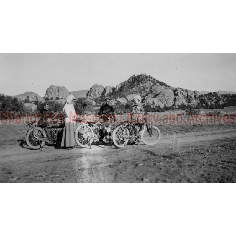 """Group of motorcycles, one is an """"Indian"""" motorcycle, possibly Granite Dells, Prescott, Arizona"""