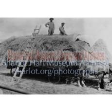 Men on hay wagon at Orchard Ranch