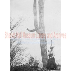 Sharlot Hall standing by saguaro cactus