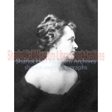 Sharlot in profile with updo hairstyle