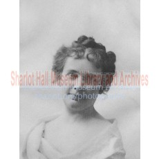 Sharlot M. Hall with Curly Bangs
