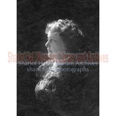 Sharlot in profile facing left