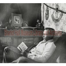 """Edward """"Ted"""" Hall Seated & Reading Book"""