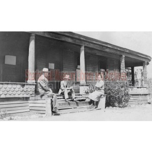 Sharlot Hall, Joe and Dave Dougherty sitting on Governor's Mansion porch