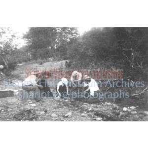 Sharlot Hall, James Hall, woman panning for gold and  3 men