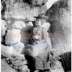 Sharlot Hall sitting among rocks