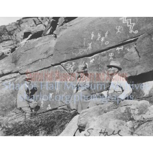 Sharlot Hall and two men sitting before Picture Rock