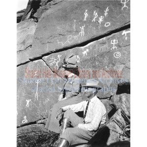 Sharlot Hall and man seated before Picture Rock