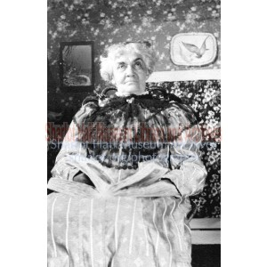 Adeline Hall in black lace collar holding book