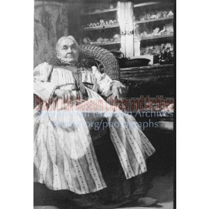 Adeline Hall seated in wicker chair