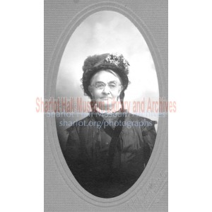 Adeline (Boblett) Hall wearing floral bonnet